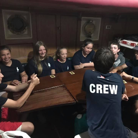 Crew and trainees having a fun conversation on Black Jack.