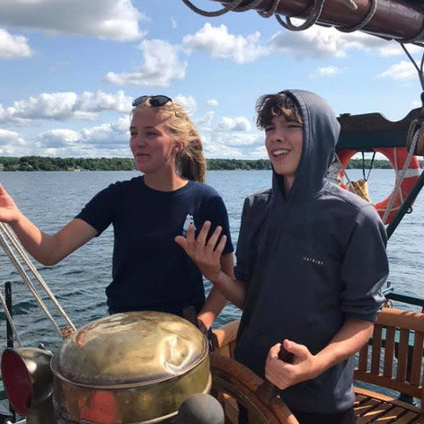 Trainee learning to helm Black Jack.