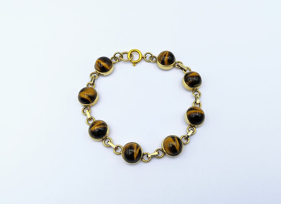 A Yellow Gold Tigers Eye Bracelet.