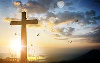 AdobeStock_161419459-Cross-Sunrise-sky-b