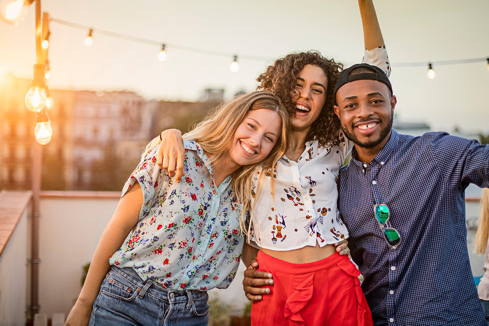 3 Healthy, Smiling Young Adults for the Writingahealthylife.com blog post entitled 'Social Support: 6 Surprising Health Benefits of Staying Connected'