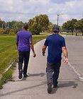 HUG PHIL & HOLLIS WALKING_edited.jpg