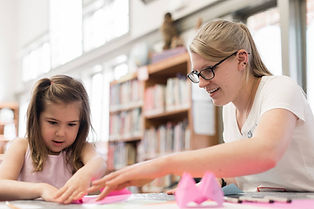 Child and staff member doing a craft at West Chester Public Library