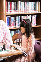 Girl playing chess at West Chester Public Library