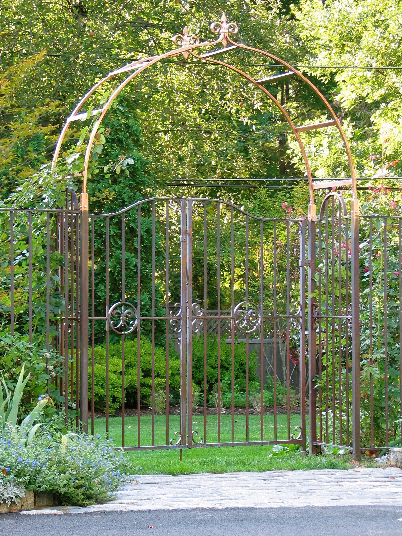 18. Solid Copper Garden Gates