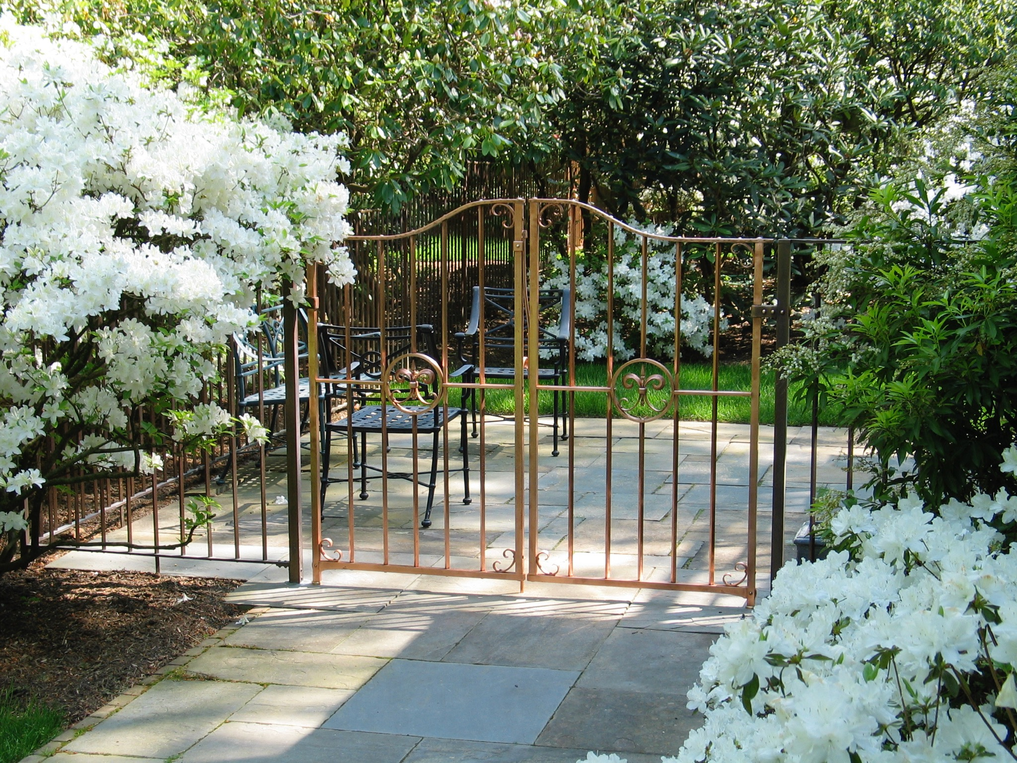 17. Solid Copper Garden Gates