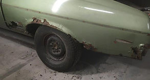 Rusted out Quarter Panel on a 1970 Acadian