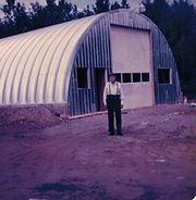 Man standing in front of garage
