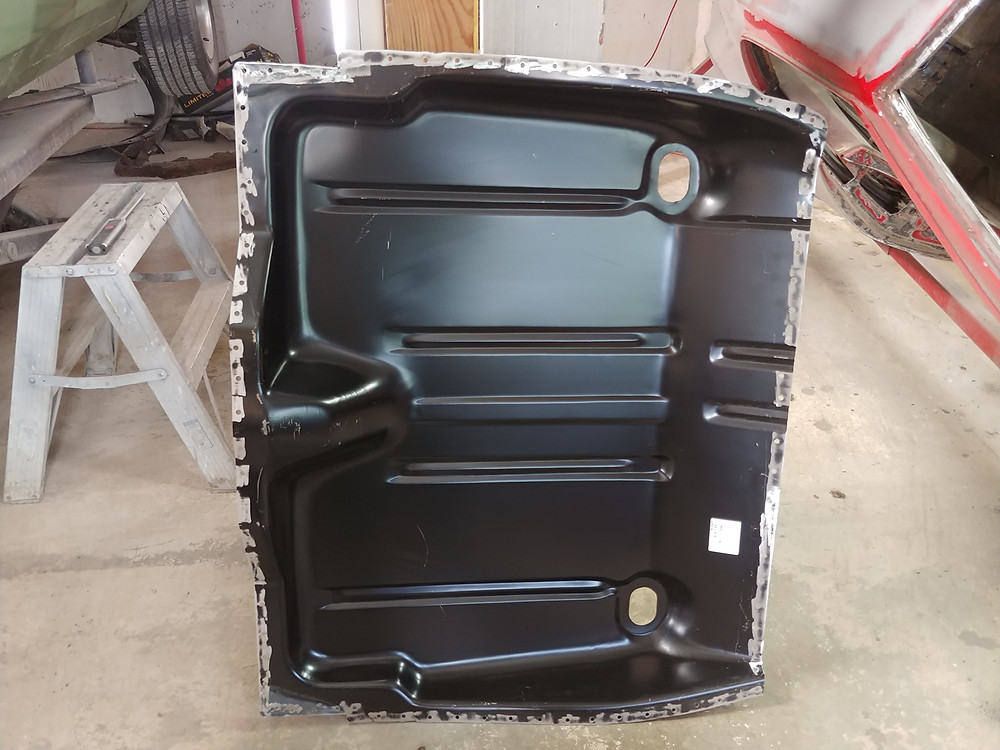 Trunk floor panel ready to be welded in
