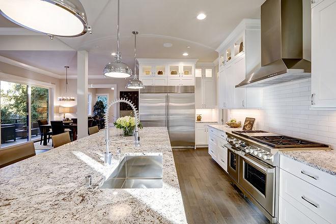 Crisp white kitchen with stone countertop