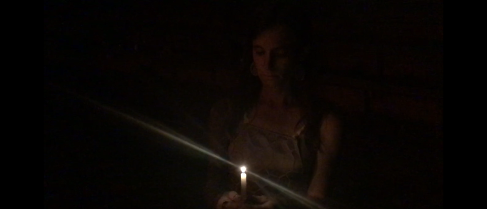 Hecuba (Molly Graves) with a candle