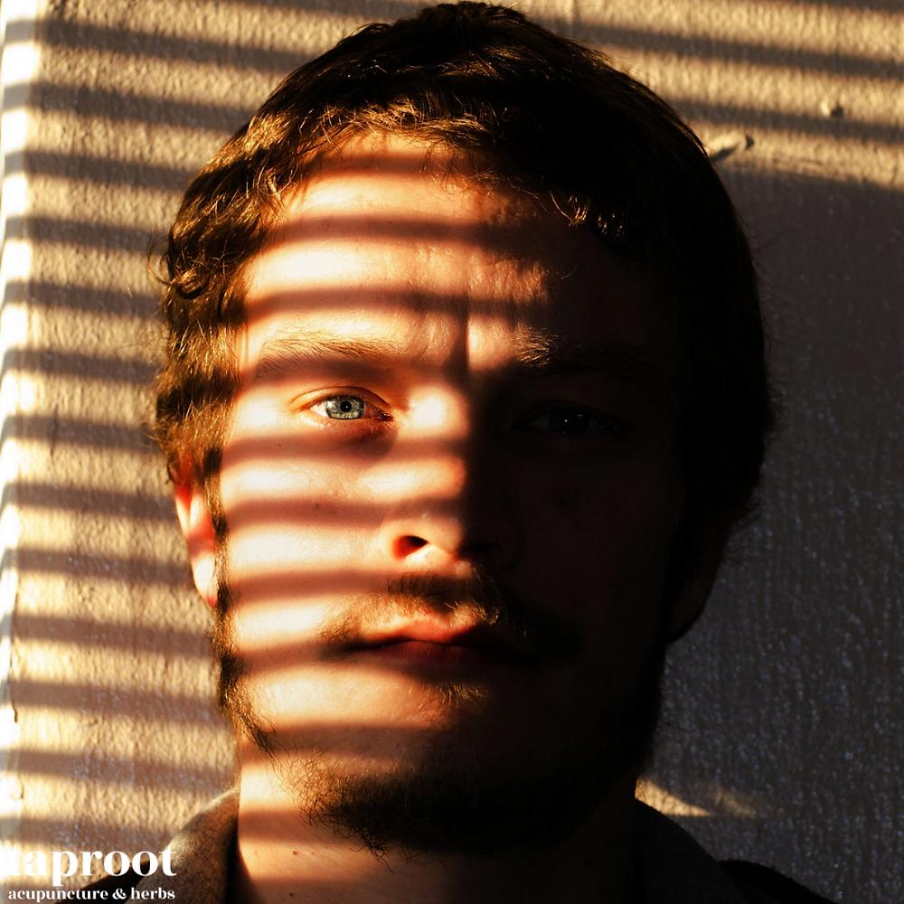 man hiding from the sun