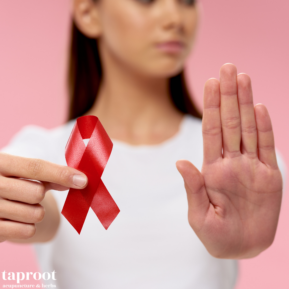 woman holding a pink ribbon for breast cancer prevention