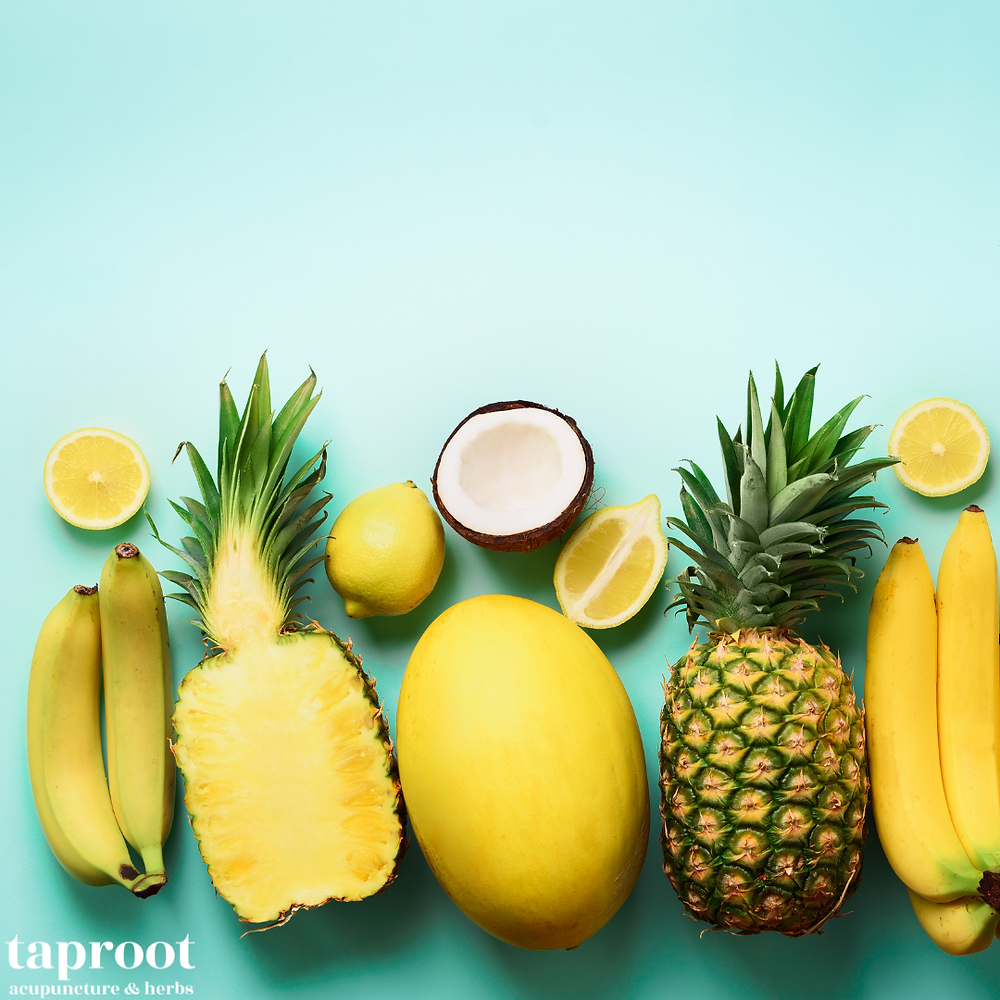 yellow colored fruit banana pineapple and lemons