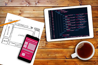 Website Wireframe Sketch And Programming Code On Digital Tablet.jpg