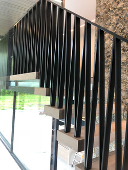 Steel balustrade in farmhouse style floating stairs