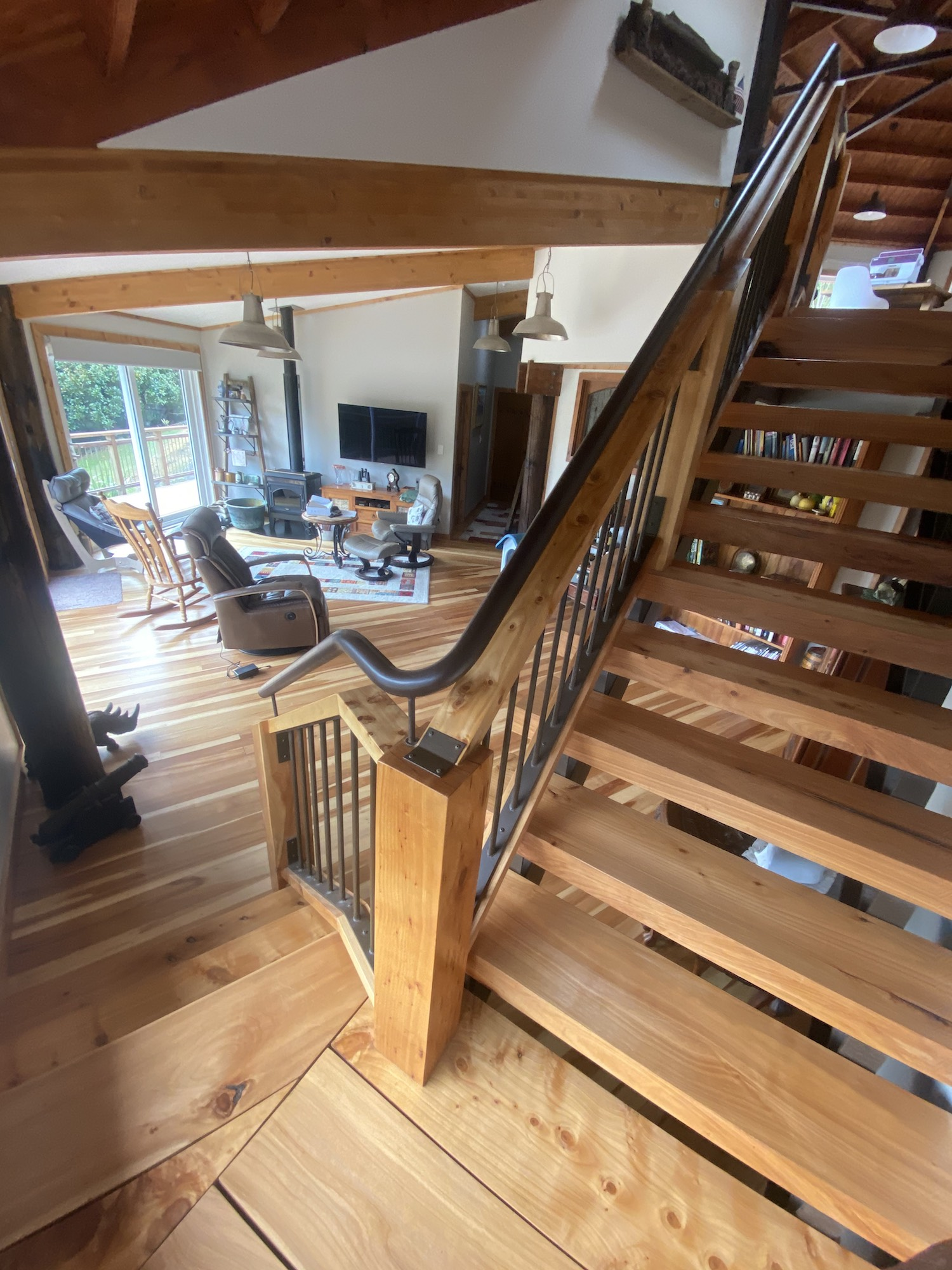 Metalwork and craftsmanship used for steel handrail on rustic staircase in Auckland