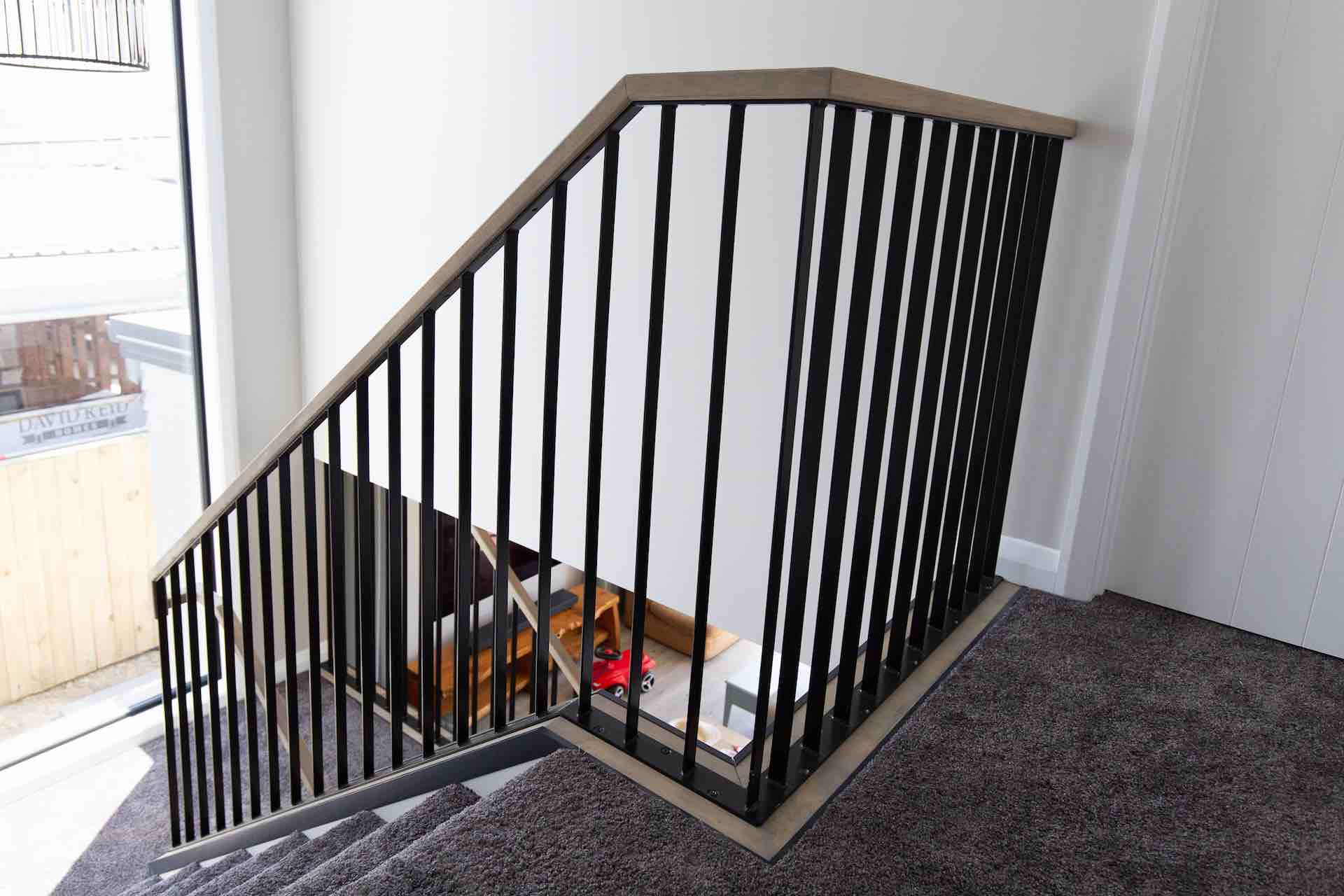 Stairworks built a steel balustrade and timber handrail in this Auckland staircase.