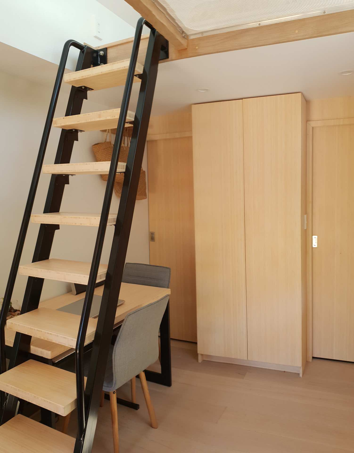 Space saving metal ladder with wooden treads in beautiful Auckland tiny home