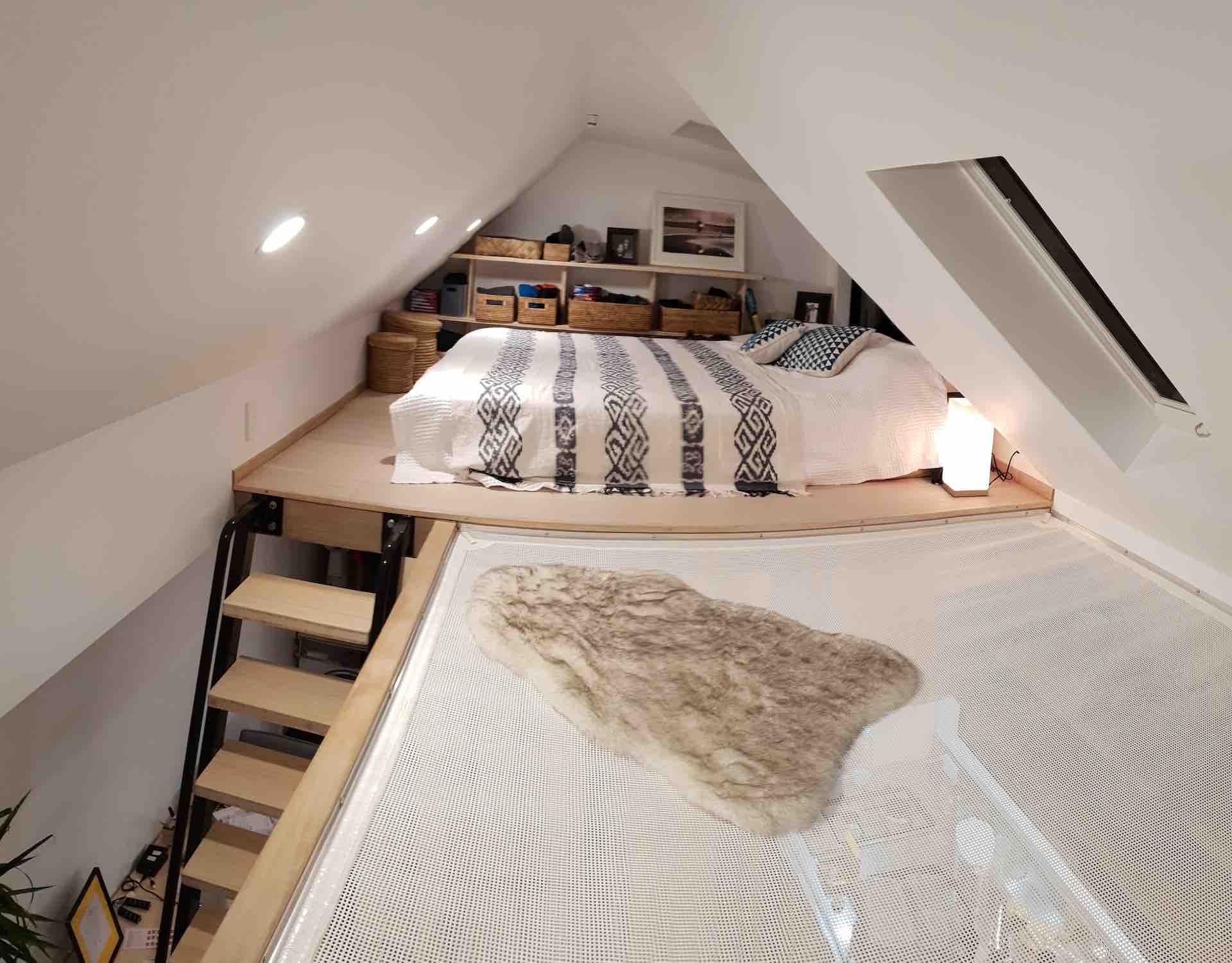 Metal ladder leads to lofted bed in Auckland tiny home