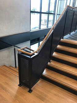 U shaped staircase in Auckland with industrial design