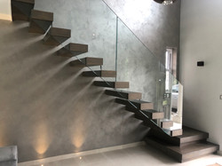 Floating stairs made of steel with glass balustrade in New Zealand