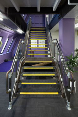 Steel staircase with landing built by staircase design business Stairworks