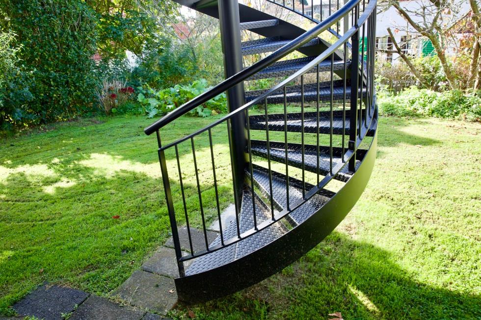 Exterior steel spiral stairs built as a backyard feature.
