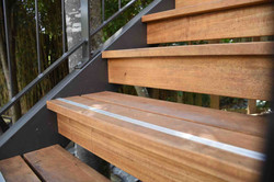 Timber treads give this exterior steel staircase a more industrial look