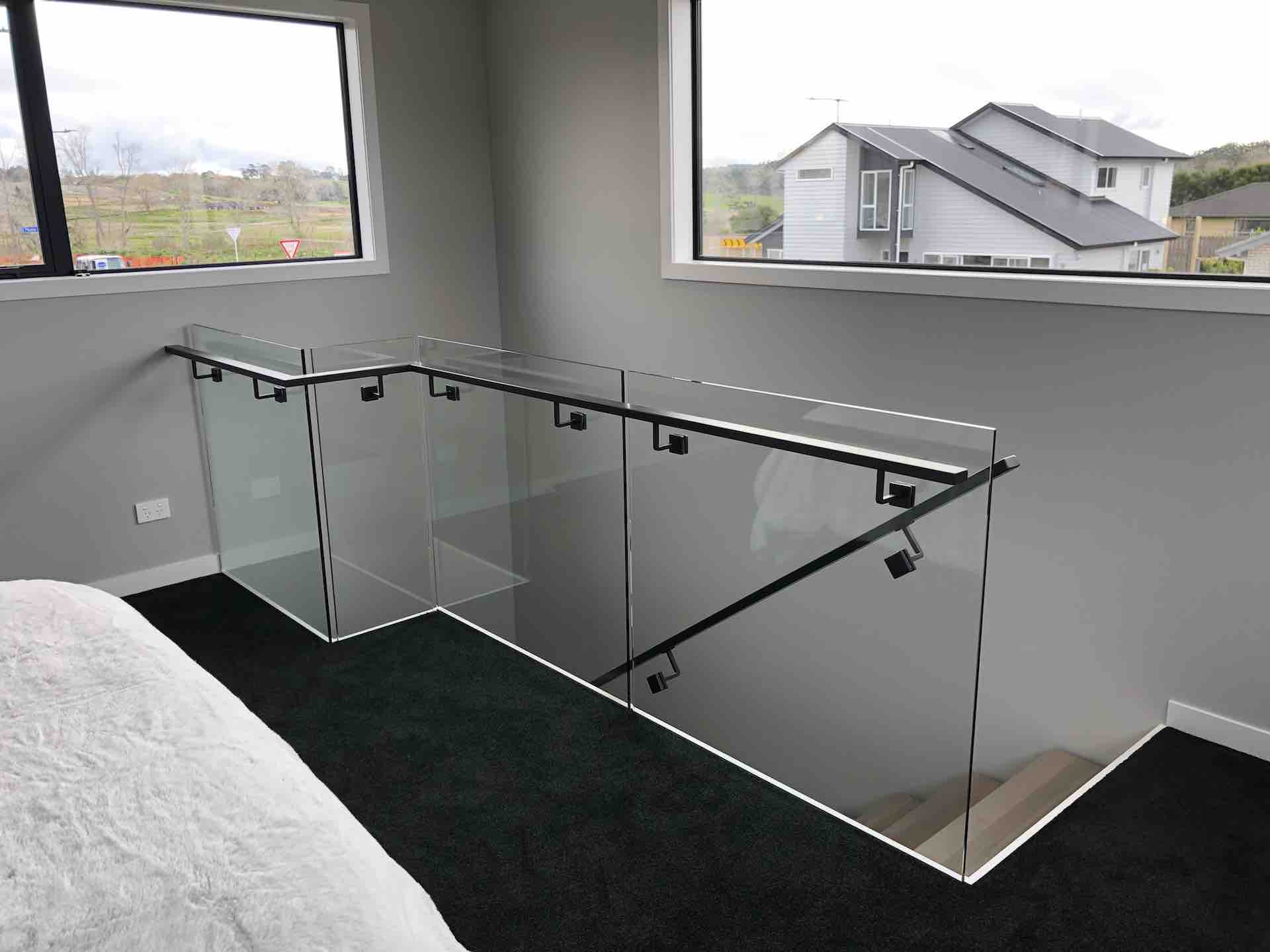 Glass balustrade allows light to come through and appear more spacious
