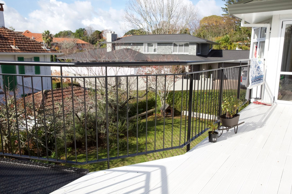 Metal balustrade and handrail on exterior steel deck in Auckland.