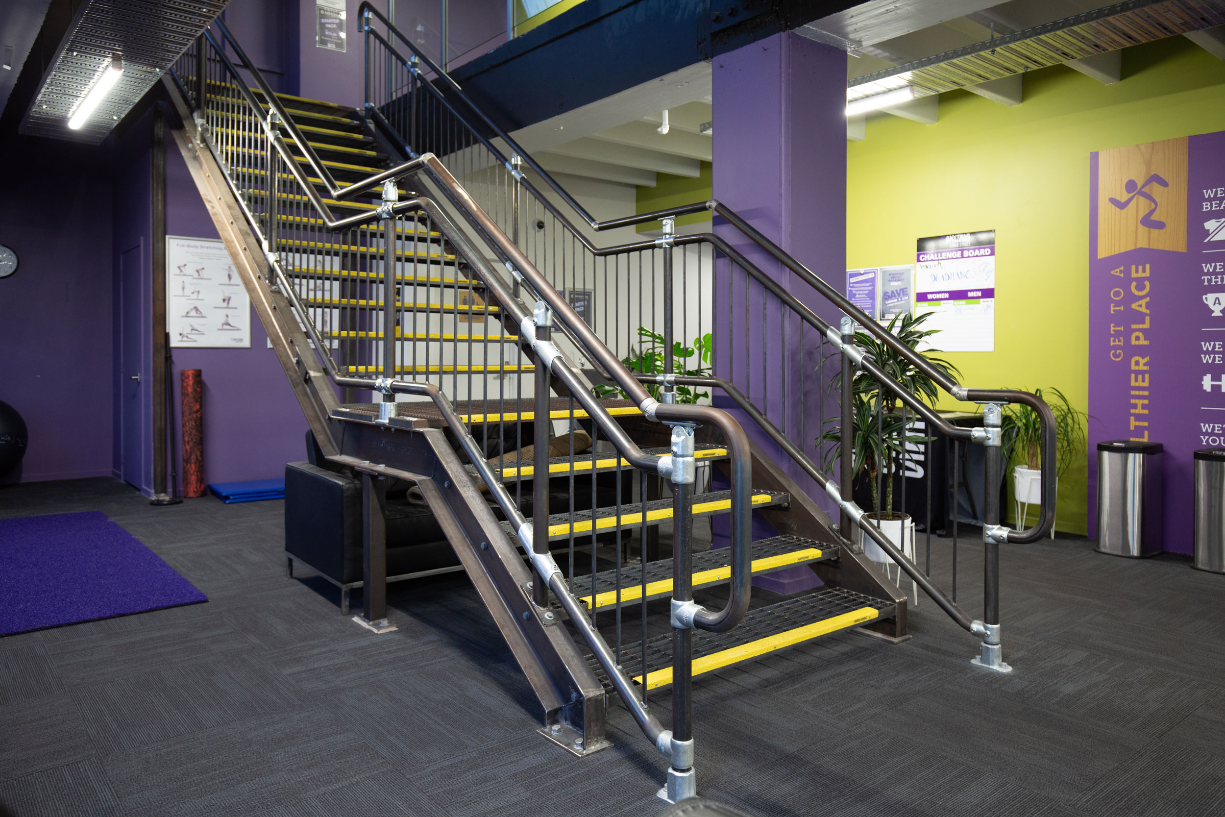 Industrial style steel staircase built by Stairworks for Anytime Fitness