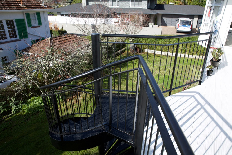 By building these outdoor stairs and deck in steel, there is more structural strength.