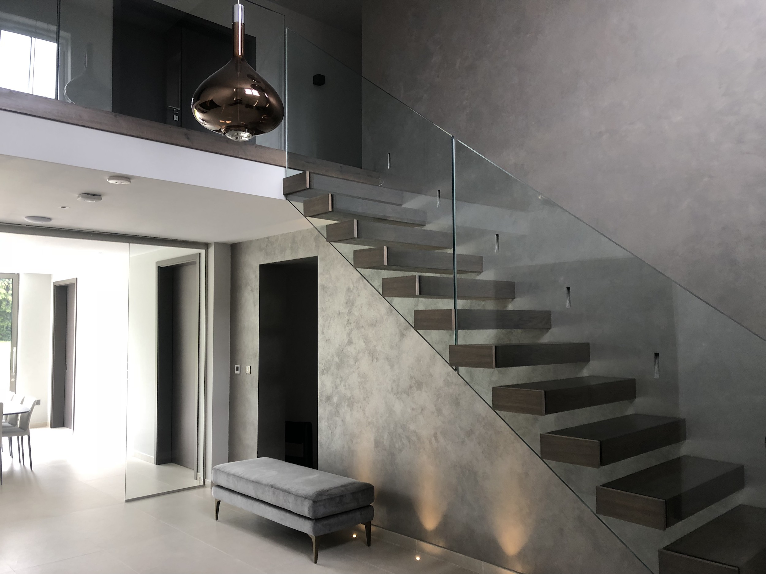 Cantilevered stairs in Auckland with wood treads