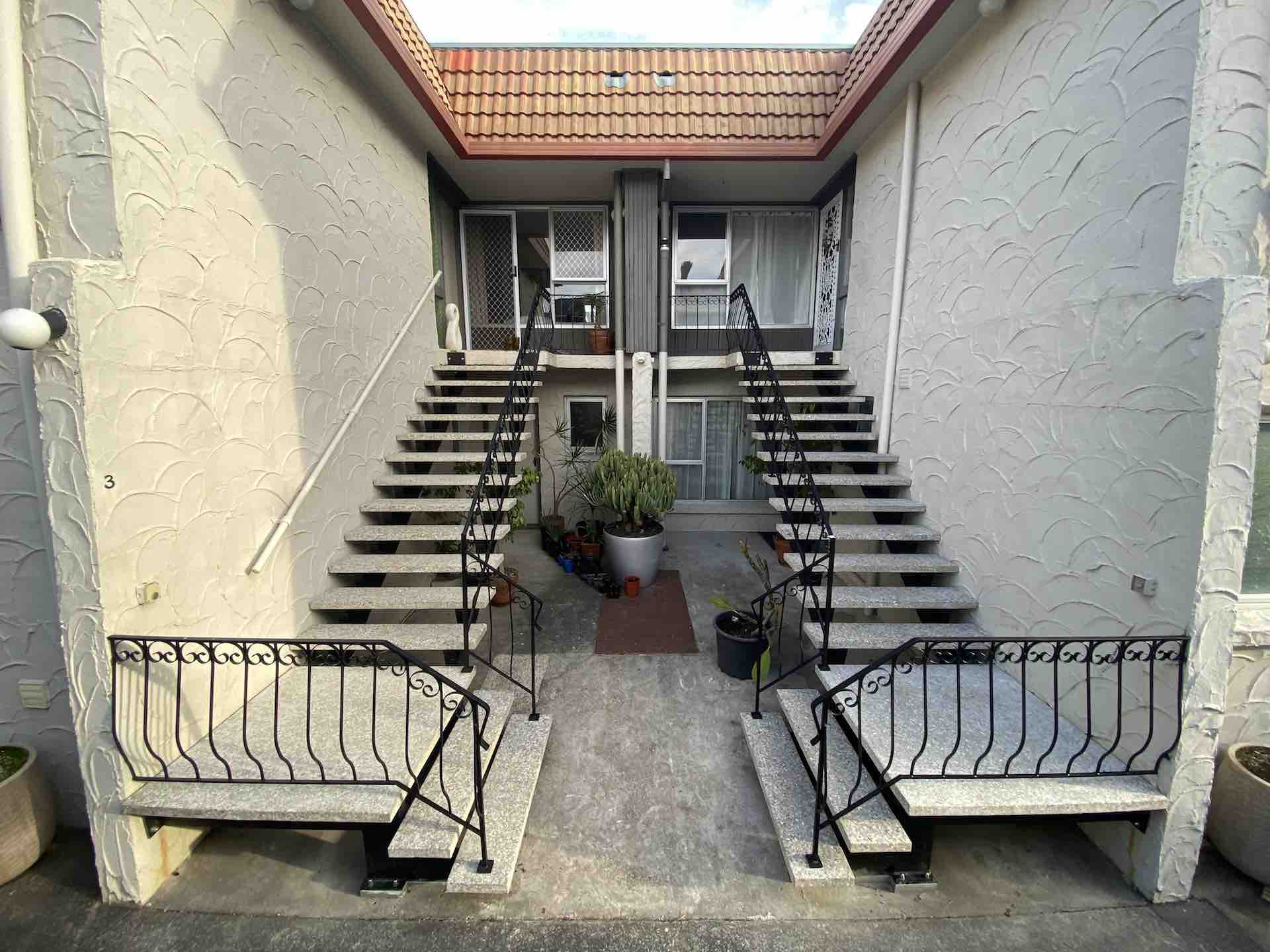Refurbished exterior staircase and metal balustrade in New Zealand