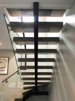 Monostringer staircase built as focal point of home