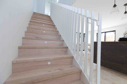 Simple staircase design with metal balustrade and timber treads in Auckland, NZ.