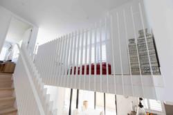 Open balustrade allows light into open floor plan home in Auckland, New Zealand