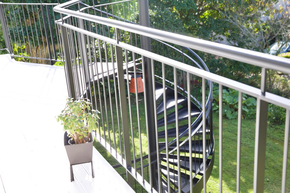 Metal balustrade of deck on outdoor staircase.