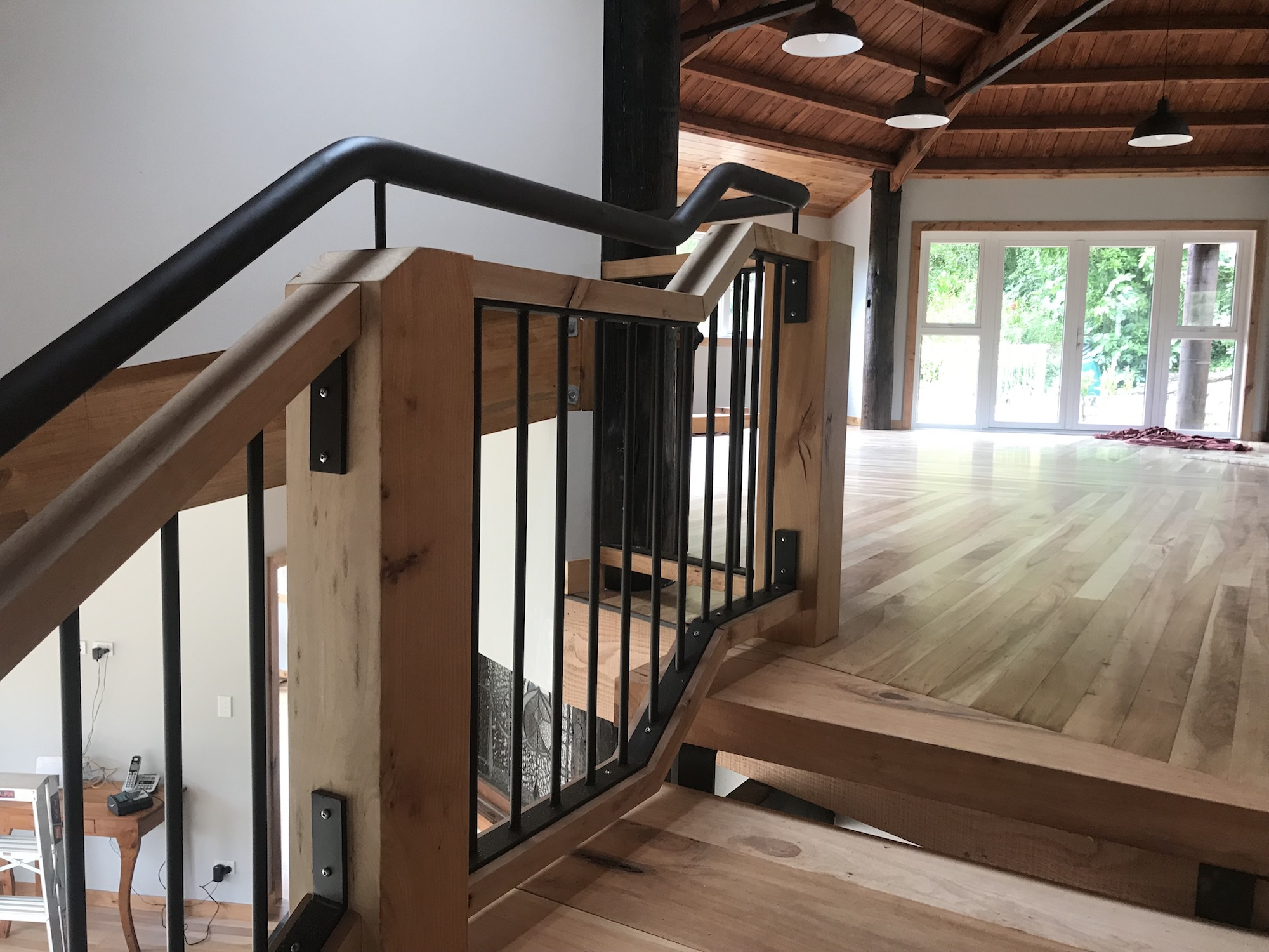 Metal balustrade and railing on wooden staircase in Auckland