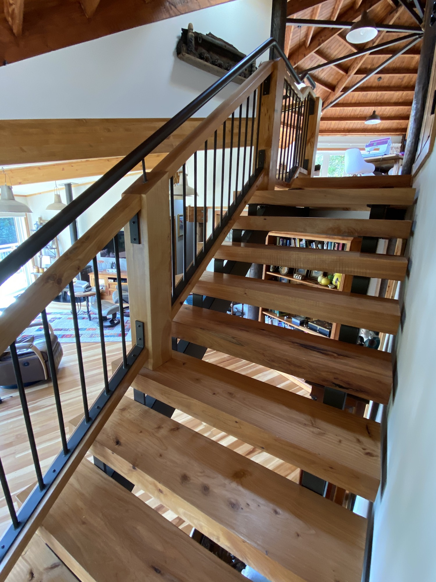 Open risers and wood treads give these stairs a clean look