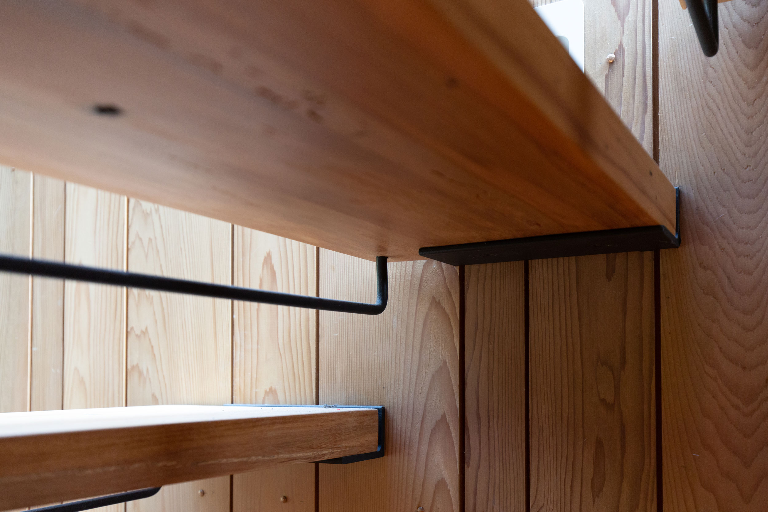 Timber treads and steel bar riser on floating staircase built by metal fabricator Stairworks