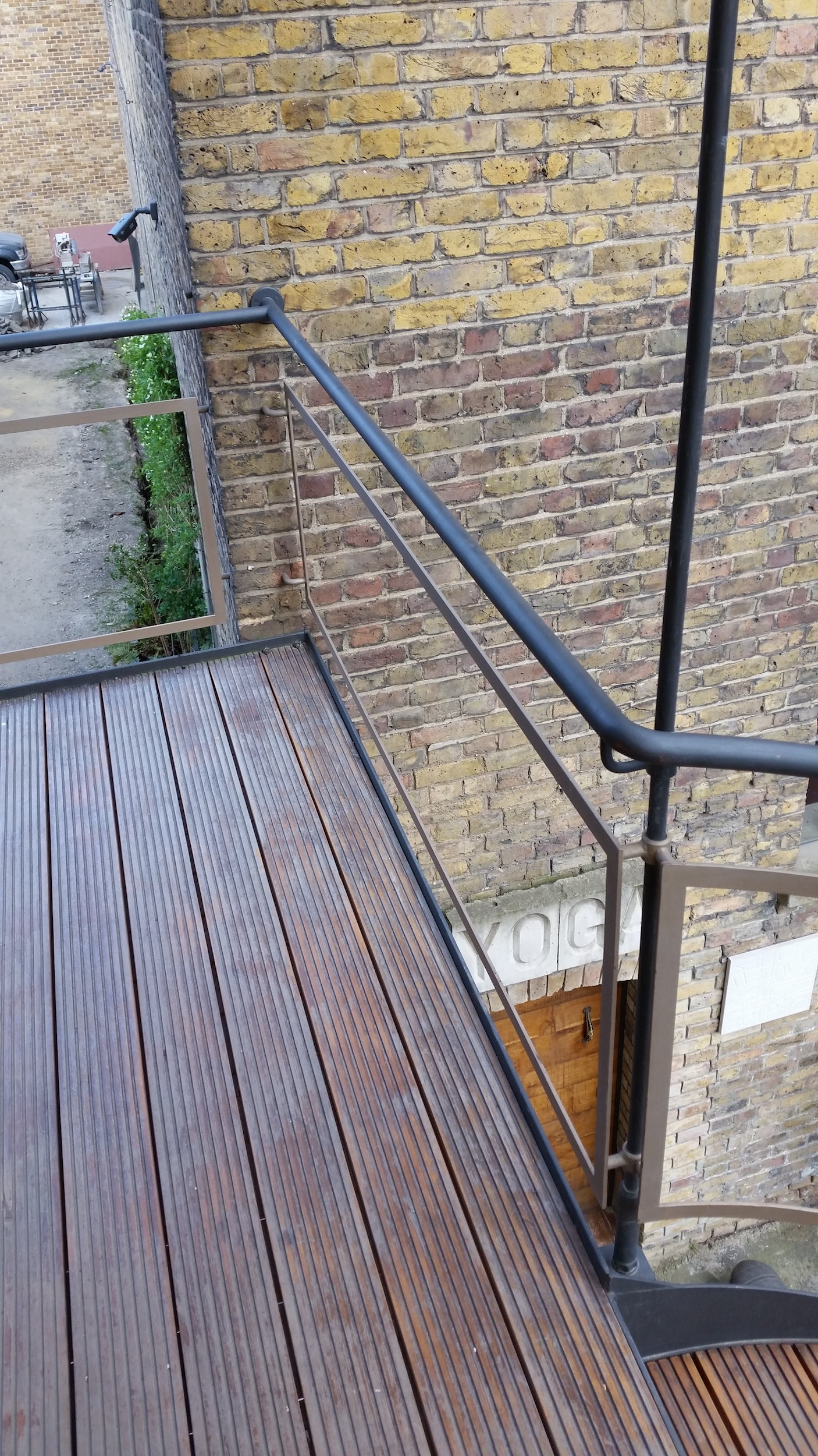 Timber landing with steel handrail manufactured by Stairworks
