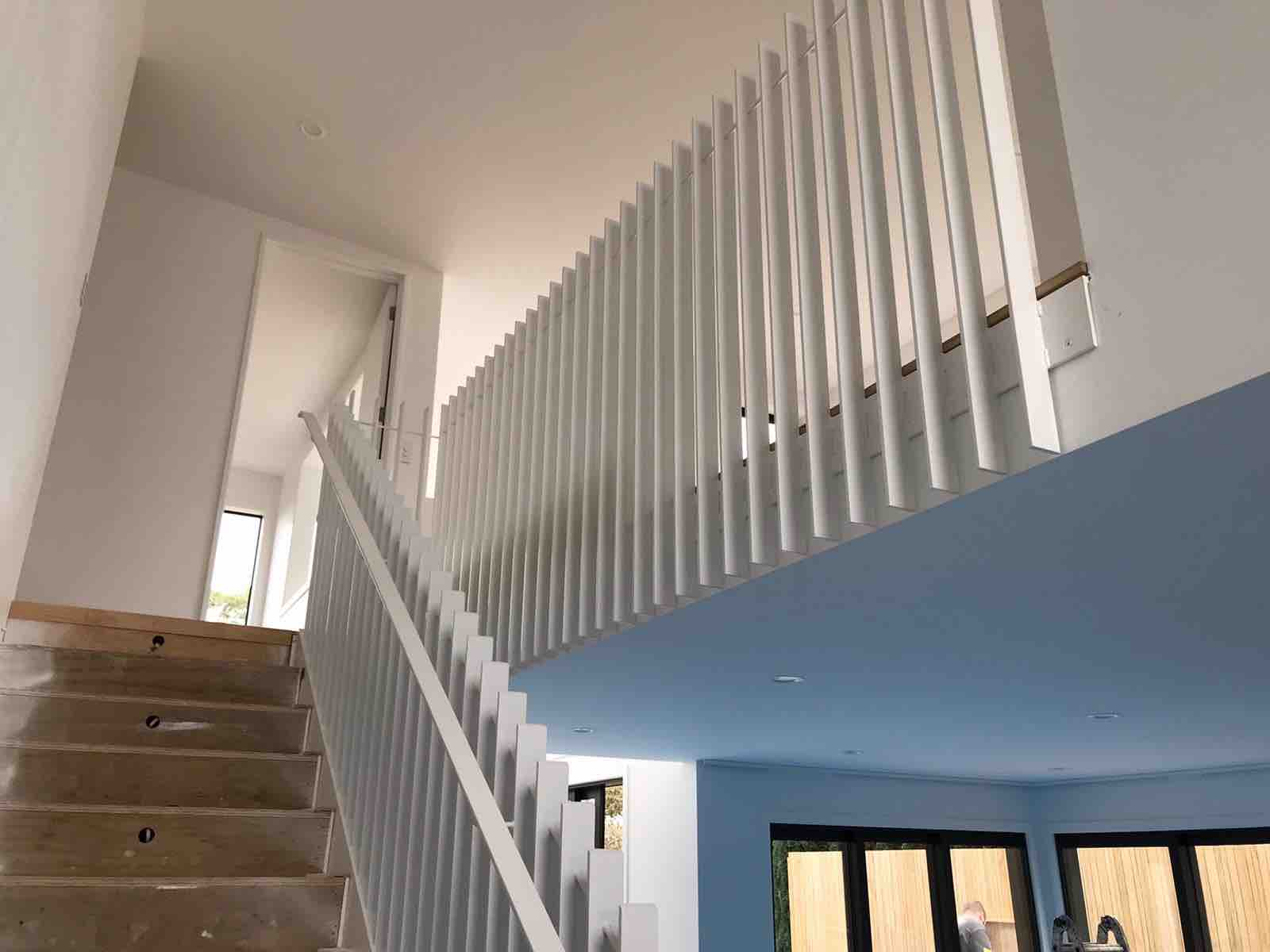 Stair renovation upgraded with new steel handrail