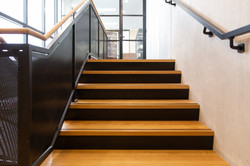 This Auckland stair renovation upgraded the interior design of the office to an industrial style loo