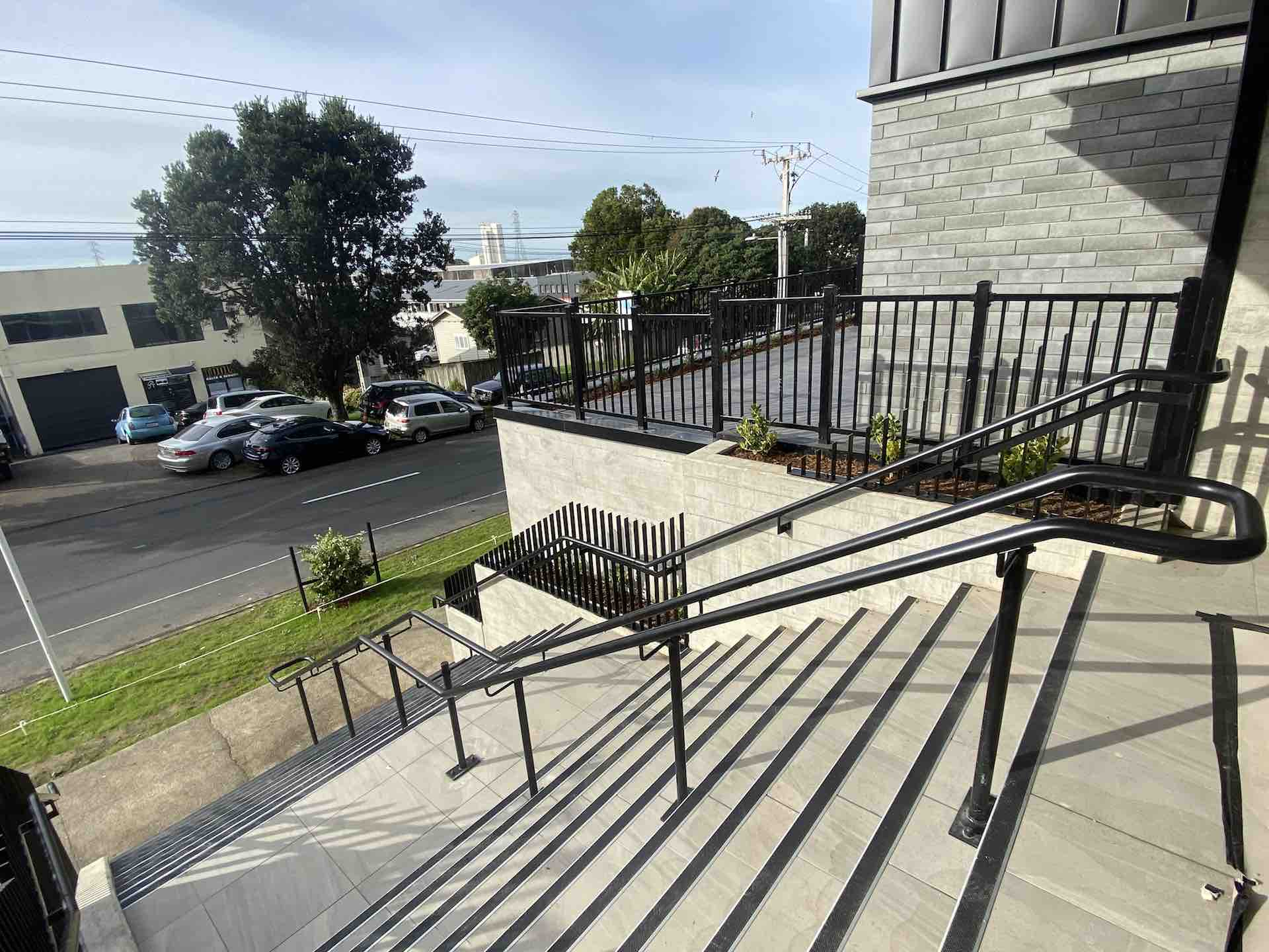 Concrete stairs with double metal balustrade and continuous handrails in Auckland