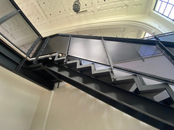 U shaped steel stairs and balustrade designed and built by Stairworks in Auckland
