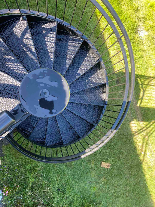 Spiral stairs with grip treads for added safety in Auckland.