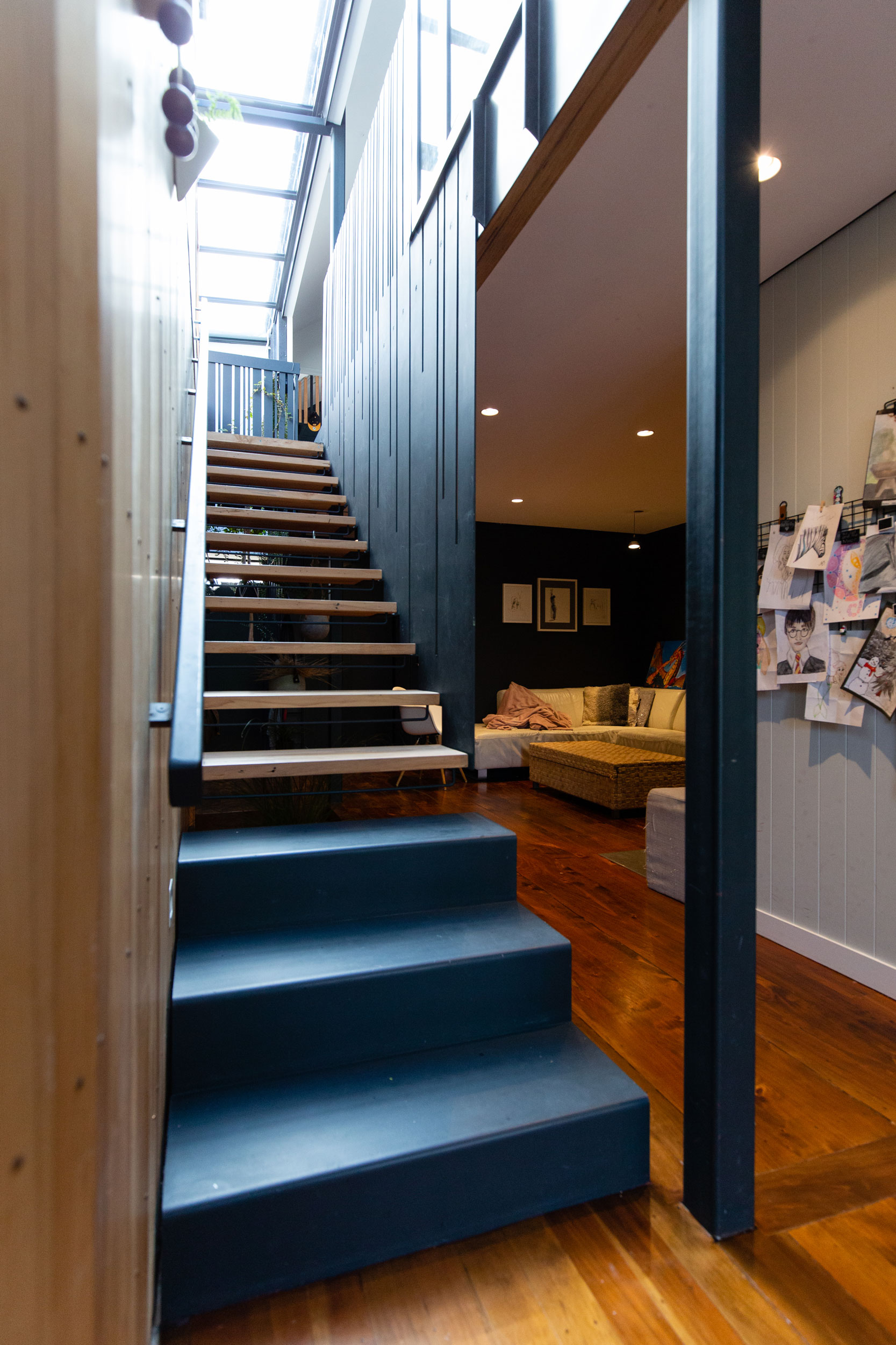 Floating staircase with timber treads and steel balustrade designed and built by Stairworks