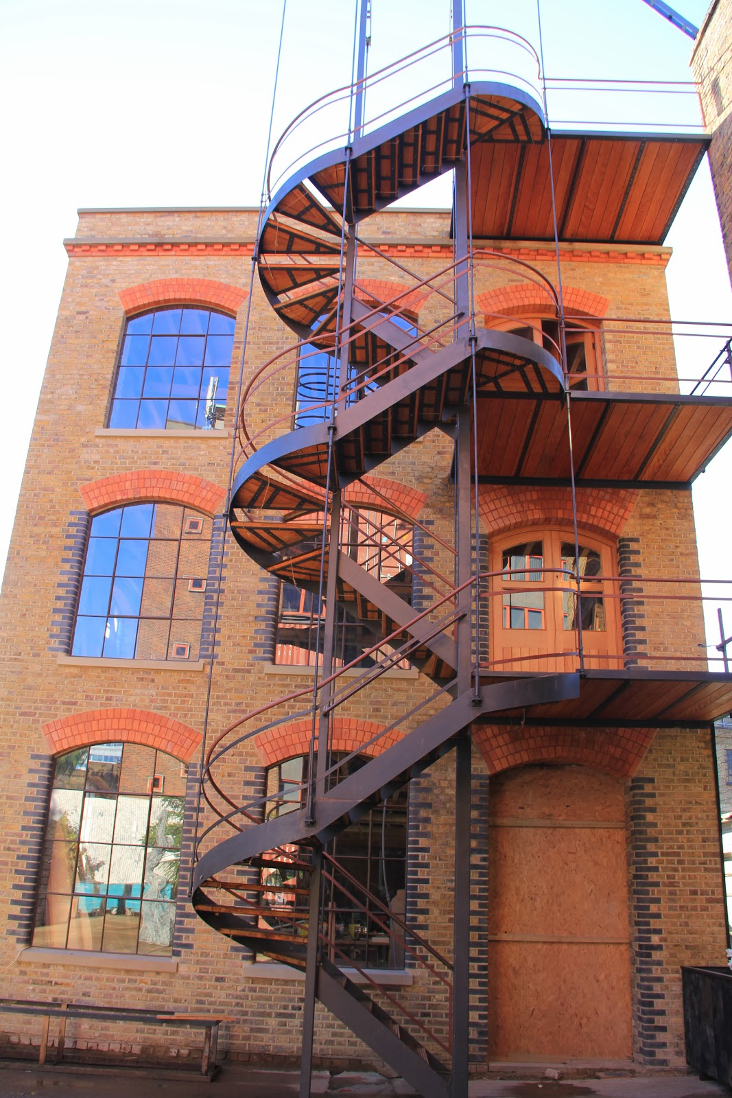 Exterior steel spiral stairs designed by Stairworks